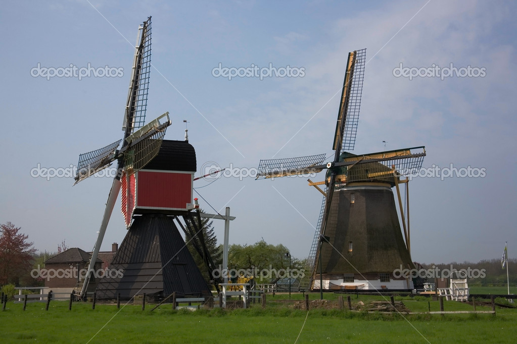 Two picturesque wind mills in the Netherlands — Stock Photo #1070704