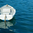 Single white boat and clear blue sea - Stock Photo