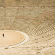 Tourist in ancient theater in Epidaurus — Stock Photo #1617698
