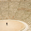Tourist in ancient theater in Epidaurus - Photo
