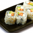 Six california rolls on a plate — Stock Photo