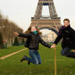 Happy couple in Paris jumping — Stock Photo