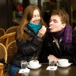 Happy couple in a Parisian street cafe — Stockfoto
