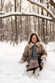 Beautiful woman in winter forest — Stock Photo