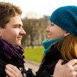Boyfriend and girlfriend looking into each other - Stockfoto