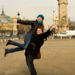 Happy couple in Paris having fun near the Pont A — Stock Photo