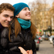 Happy loving couple in Paris, hugging on a stree — Stock Photo