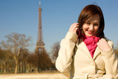 Happy beautiful woman in Paris at sunny spring d — Stock Photo