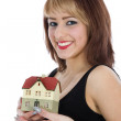 Business woman advertises real estate — Stockfoto