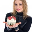 Business woman advertises real estate — Stock Photo #1286149