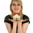 Business woman advertises real estate — Stock Photo #1294824