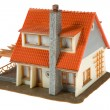 Miniature house with dollars isolated — Stock Photo #1372544