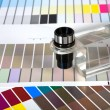 Color Guides with magnifying glass - Stock Photo