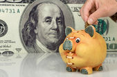 Piggy bank on big dollar background — Stock Photo