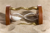 Clessidra su sabbia bacground — Foto Stock