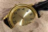 Clok on sand bacground — Stock Photo