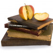 Royalty-Free Stock Photo: Apple on pile of old books