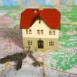 Miniature house on map — Stock Photo