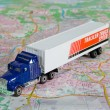 Lorry on a map — Stock Photo
