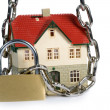 House  locked with padlock - Stock Photo