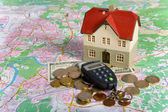 Miniature House on Money — Stock Photo