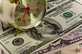 Dollars and clock — Stock Photo
