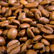 Fried brown coffee beans close up — Stock Photo #1556769