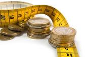 Mynt med meter på vit — Stockfoto