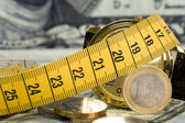 Coins with metre — Stock Photo