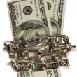 Dollars with chain on white background - Stock Photo