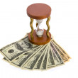 Dollars and hourglass on white — Stock Photo #1570371