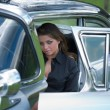 Young girl in old-fashioned car — Stock Photo #1611414
