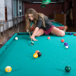 Girl in short skirt playing snooker — Stock Photo #1612317