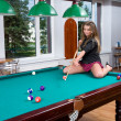 Royalty-Free Stock Photo: Girl in short skirt playing snooker