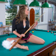 Girl in short skirt playing snooker — Stock Photo #1612647