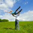 Young family jumping — Stock Photo #1622023
