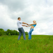 Young family jumping — Stock Photo