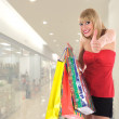 Expressive woman shopping - Foto Stock