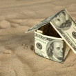 Dollar house on sand. — Stock Photo #1648317