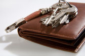 Bunch of keys on leather wallet — Stock Photo