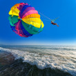 Man is parasailing — Stock Photo