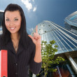 Royalty-Free Stock Photo: Business woman advertises real estate