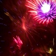 Colorful fireworks over a night sky - Stock Photo