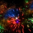 Colorful fireworks over a night sky — Stock Photo