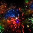 Colorful fireworks over a night sky — Stock Photo #1701829