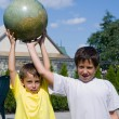 Brothers and globe — Stock Photo