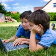 Three cute brothers study on computer — Stock Photo #1728123