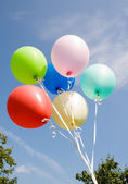 Varicoloured balloons on background sky — Stock Photo