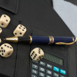 Calculator, pens, dice — Stock Photo