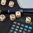 Calculator, pens, dice - Stock Photo